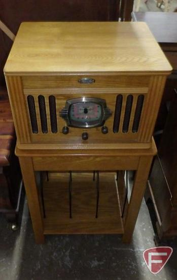 Crosley stereo system (turntable/radio/cassette player) Model CR-67 on wood stand with album holders