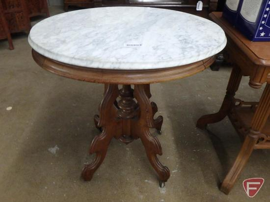 25in round occasional table, with marble top, on wheels, 29inH