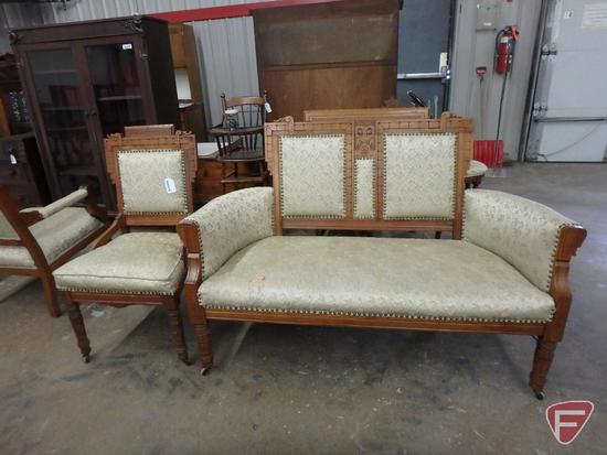 Wood framed settee with upholstered seat and back, with nailhead trim, wheels on front, 58inW,