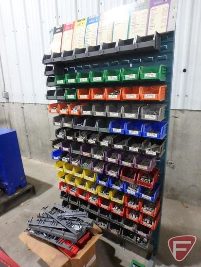 Wheel balancer weight organizer rack with contents: sorted wheel weights
