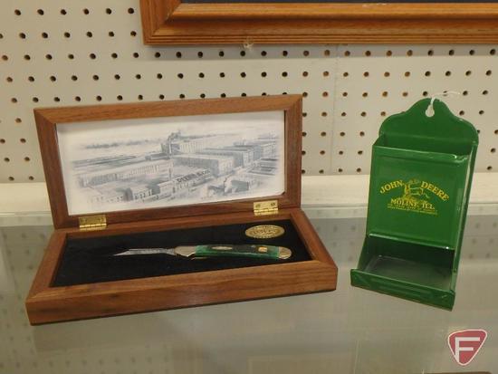 Case John Deere pocket knife in wood display box and metal John Deere wall matchstick holder. Both.