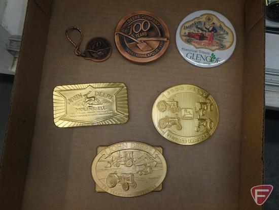 (3) gold colored John Deere belt buckles, (1) brass John Deere belt buckle with matching keychain,