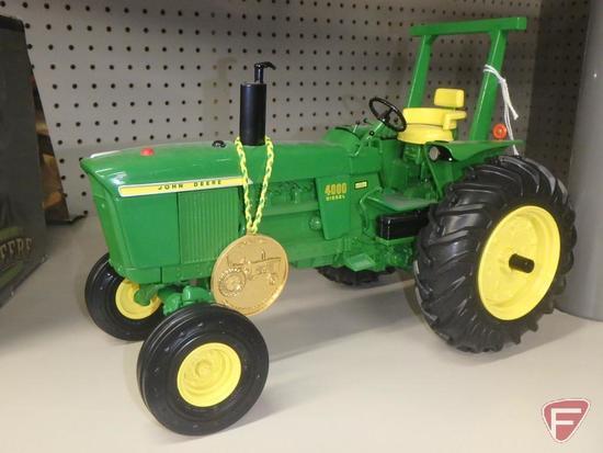 Ertl replica John Deere 4000 diesel tractor with commemorative coin.