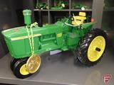Ertl replica John Deere 4020 diesel tractor with commemorative medallion