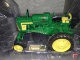 Ertl replica John Deere 620 tractor, 2006 Sales Performance Award, some broken parts but included,