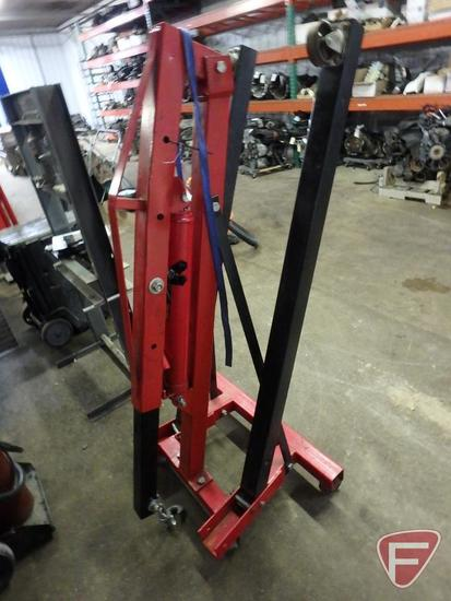 2 Ton engine hoist with fold up stabilizer arms on steel casters