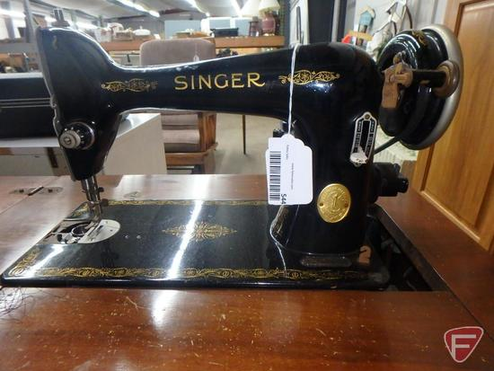 Singer sewing machine in cabinet with bench