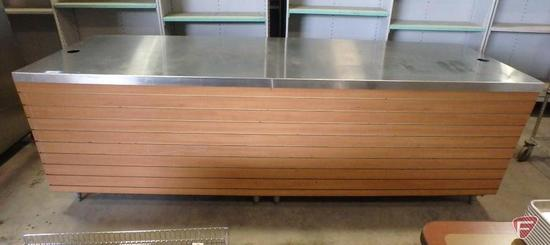 Cashier's counter with wood facade and stainless steel counter, metal base