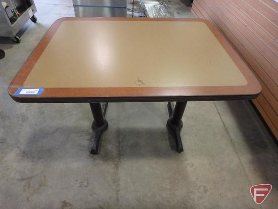 Dining room table with handicap symbol on edge
