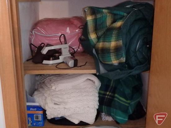Bedding, sleeping bag, heating pads. Contents of closet