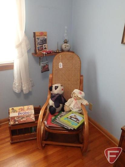 Bentwood rocker, Reminisce books, kerosene lamp, magazine rack, and games.