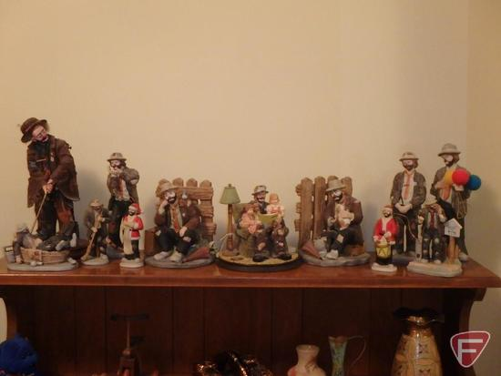 Emmett Kelly figurines and bookends. All items on top shelf of bookcase.