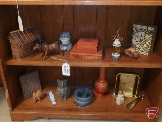 Brass shoe bookends, metal vases, Seiko tabletop clock and other decorative items.