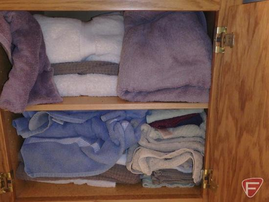 Towels-all in cupboard, plastic hamper and hanging