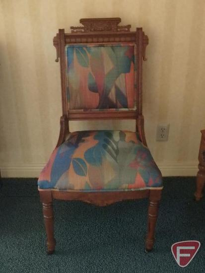 East Lake fabric covered wood chair on rollers