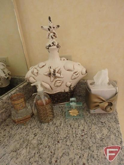 Seashell decanter, glass ashtray and goldwash glass, butterfly pictures, bath salts.