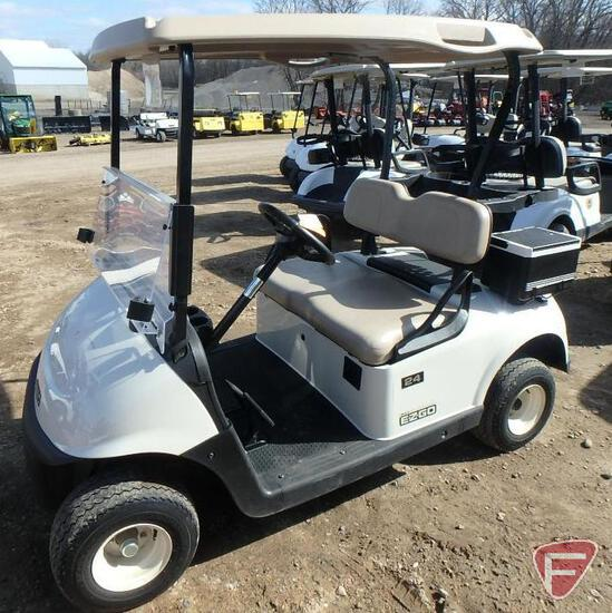 2016 EZ-GO RXV electric golf car with canopy, windshield, and cooler; white, sn 5398096