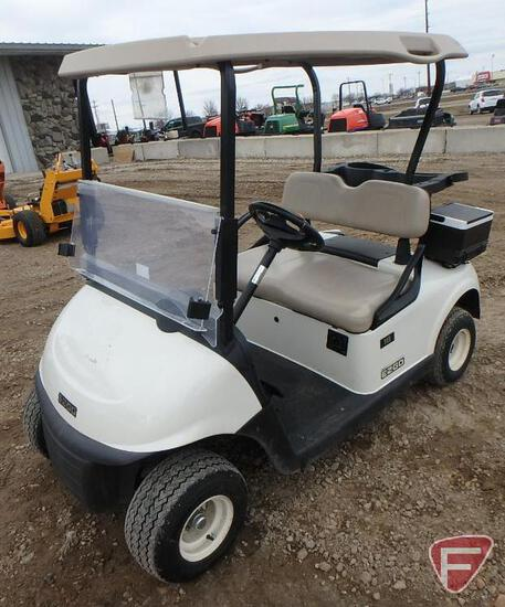 2016 EZ-GO RXV electric golf car with canopy, windshield, and cooler; white