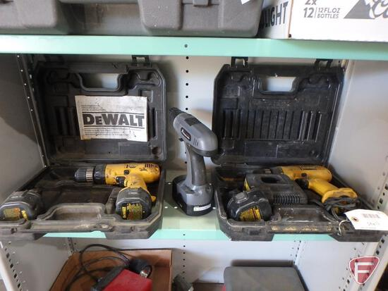 DeWalt cordless power tools: 9.6v drill, (2) 9.6v batteries, 12v drill, (1) 12v battery, (1) charger