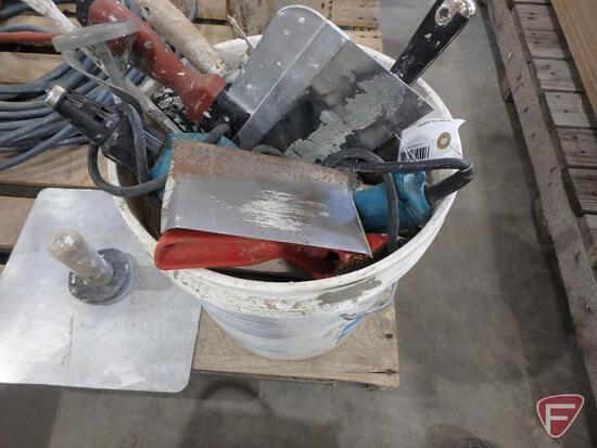 Masonry trowels, stapler, Makita drywall screw gun, putty knives, drywall tools
