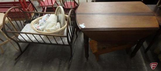 Drop leaf table on wheels, cradle, basket with blankets and picture, bench