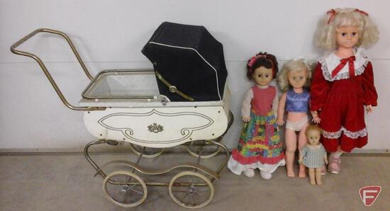 Vintage doll buggy and 4 dolls with sleepy eyes