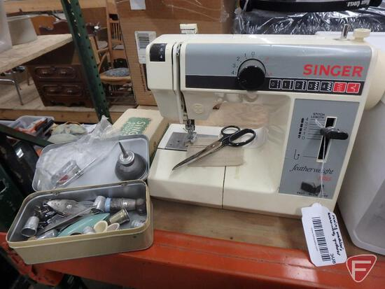 Singer Featherweight sewing machine, no cord, thimbles, other accessories, patterns
