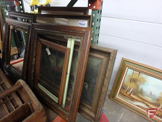 Large assortment of pictures and frames of various sizes