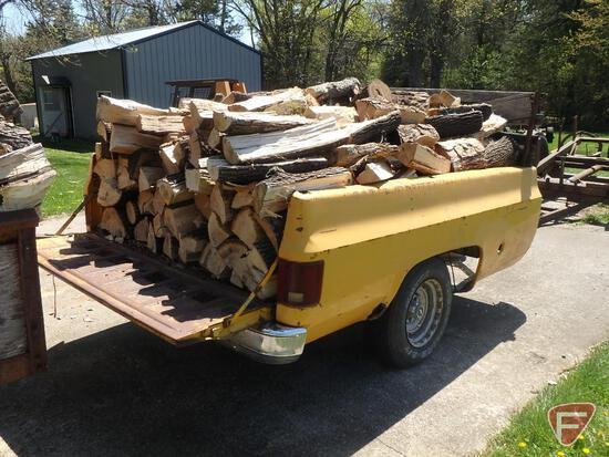 Chevrolet truck box made into trailer full of dry wood