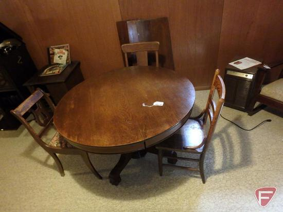 "Vintage 45"" round pedestal table with (4) 12"" leaves, and (3) non-matching wood chairs."