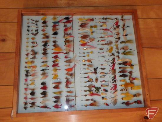Vintage fishing lures in hanging display case: