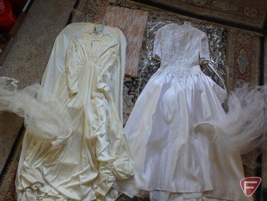 Contents of closet; two wedding dresses, hanging clothes, boots, gloves, purses, shoe stretchers