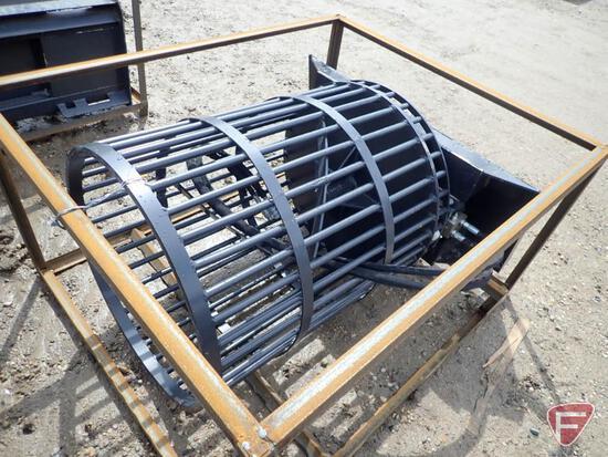 Unused Wolverine rotary rock picker skid loader attachment
