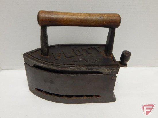 Flott cast iron charcoal iron; lever latch; fish in ring design