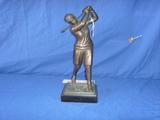 Bronze female golfer