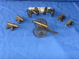 7 small brass cannons