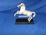 Stallion mounted on wood
