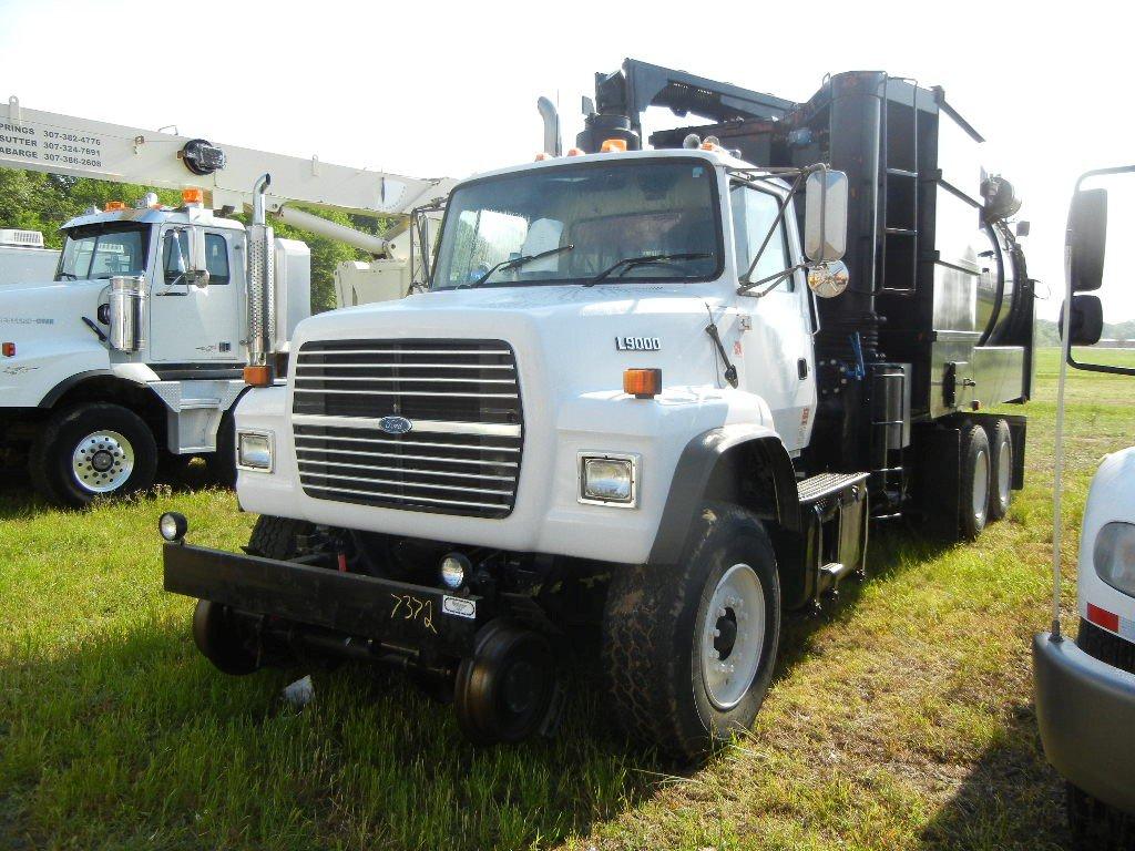 1995 FORD L9000 VACUUM TRUCK, 116,657 mi,  HY RAIL, CATERPILLAR DIESEL, 10