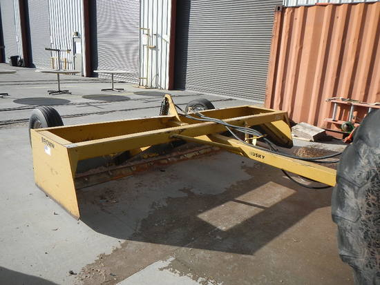 HUSKY/BROWN 12' HYDRAULIC BLADE   LOAD OUT FEE: $5.00