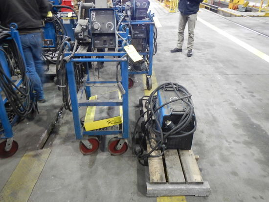 MILLER XMT 350 WELDER WITH MILLER 70 SERIES WIRE FEEDER,  MIG GUN, ON ROLL-