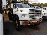1993 FORD F700 DUMP TRUCK, 228,429 miles  FORD DIESEL, 5+2 SPEED, 9' BED, S
