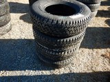 (4) 235/75R15 TIRES