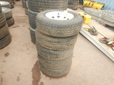 (5) ST205/75R14 TRAILER TIRES  AND WHEELS