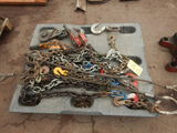 PALLET WITH HEAVY DUTY SHORT CHAINS, LIFTING HOOKS, SNATCH BLOCKS AND MISC