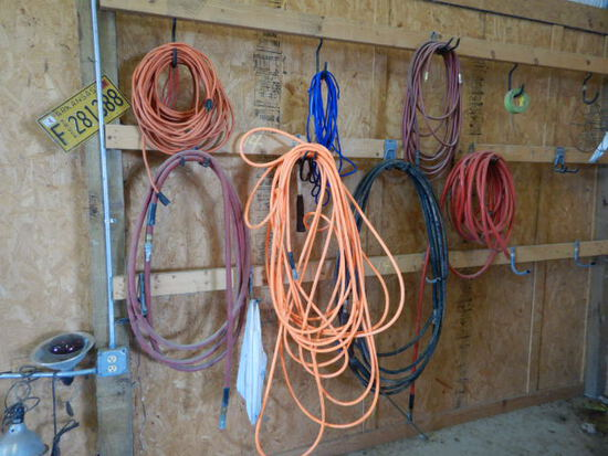 AIR HOSES AND EXTENSION CORDS  (ON SHOP WALL)