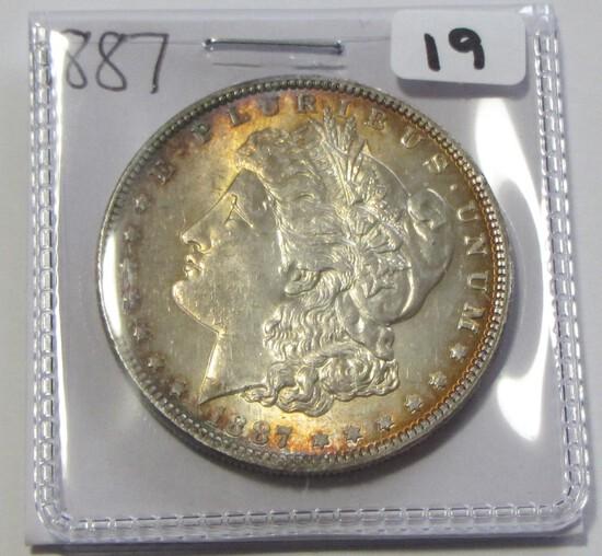 $1 1887 TONED BU MORGAN