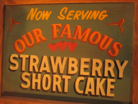 "Famous Strawberry Shortcake sign paint on chalkboard 24"" X 18""- staining"