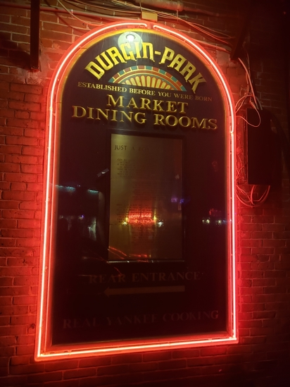 "Durgin Park Dining Room wood with ""Just a boy"" poem on brass neon border 88 X 52"