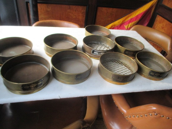 8 antique brass sifters and pan