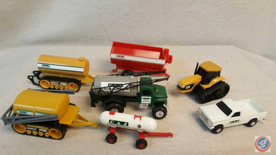 (7) ERTL die cast farm equipment pieces including: Tanker w/sprayer and tiller, Ford truck, Red